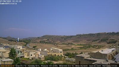 Daylight webcam view from Victoria › North West: Gozo − case, strade, colline mare